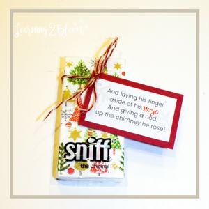22. And laying his finger aside of his nose, and giving a nod up the chimney he rose! tag tied to cute Christmas tissues.